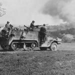 GIs in M3A1 half track attack near Wiezemburg Germany 1945