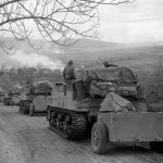 11h Armored Division M7B1 Priest Battery Rolls into Burning Obernust Germany April 1945