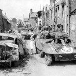 M8 Greyhound Armored Cars of the 2nd Cavalry Group (Mechanized) Enter Brehal Normandy August 2 1944