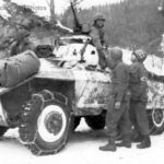Troops of 84th Division shake hands with an M8 armored car crew