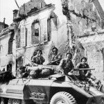 US Soldiers of Recon Unit in M8 Scout Car In Mountebourg France