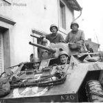 US soldiers in M8 of the 106th Cavalry Regiment in small French village