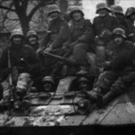 German soldiers and M8 Greyhound
