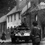 M8 Greyhound of the 82nd Armored Reconnaissance Battalion at St. Lo