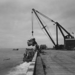 Crane Loads Truck Into Landing Craft On Biak 1944