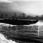 Assault wave in Higgins boat hitting the Bougainville beach