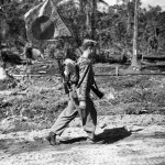 Marine with captured japanese battle flag on Bougainville
