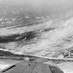 Landing craft approaching Eniwetok In the foreground is a Japanese airfield