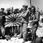 Marines Display Captured Japanese Flag on Engebi