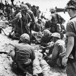 Marines Give Plasma to Wounded Soldier on Eniwetok Pacific