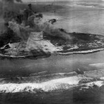 Smoke rises from Eniwetok after attacks by US Navy carrier aircraft 3 February 3 1944