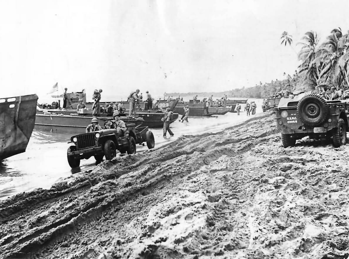 Marines Jeeps and landing barges on Guadalcanal Beach 1942