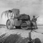 Marine guards a captured Japanese steamroller at airfield on Guadalcanal 1942