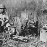 Marine with captured Japanese Type 92 70 mm light howitzer Guadalcanal 1942