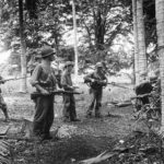 Marines search for Japanese snipers on Guadalcanal 1942