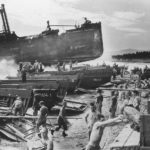 Troops on Beach by Wrecked Kinugawa Maru on Guadalcanal 1943
