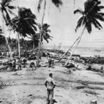 US LCVP PO-20 unloads fuel drums at Kukum Guadalcanal 1942