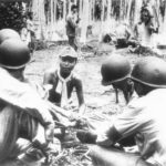 US Officers Question Japanese Prisoner on Guadalcanal 1942
