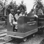 "US officers ride on the ""Guadalcanal, Bougainville & Tokyo Express"" Railroad built by Seabees on Guadalcanal 1943"