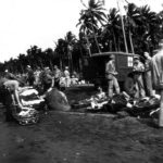 Wounded Troops Await Transport on Guadalcanal Beach 1943