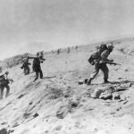 4th Division Marines move up beach on Iwo Jima