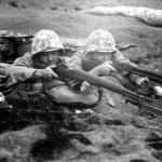 A pair of Marines in a dug out position await a Japanese counter attack