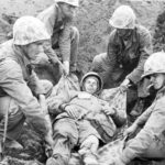 Iwo Jima moving wounded Marine