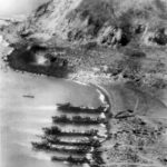 LSTs and one LCM beached at the foot of Mount Suribachi
