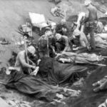 Marine Corpsmen treat wounded Beach Iwo Jima 1945