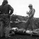 Marine gives plasma to wounded soldier on Iwo Jima