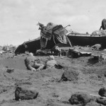 Marines Use Japanese Plane For Cover on Motoyama Airfield Iwo Jima