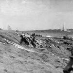 Marines under heavy fire on beach of Iwo Jima