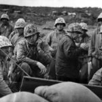 Officers of the 5th Marine Div direct operations from a sandbagged position