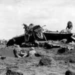 Wrecked Japanese aircraft and Marines on Motoyama airfield Iwo Jima