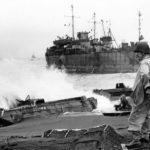 Wrecked LVT and DUKW and LST on Iwo Jima February 1945