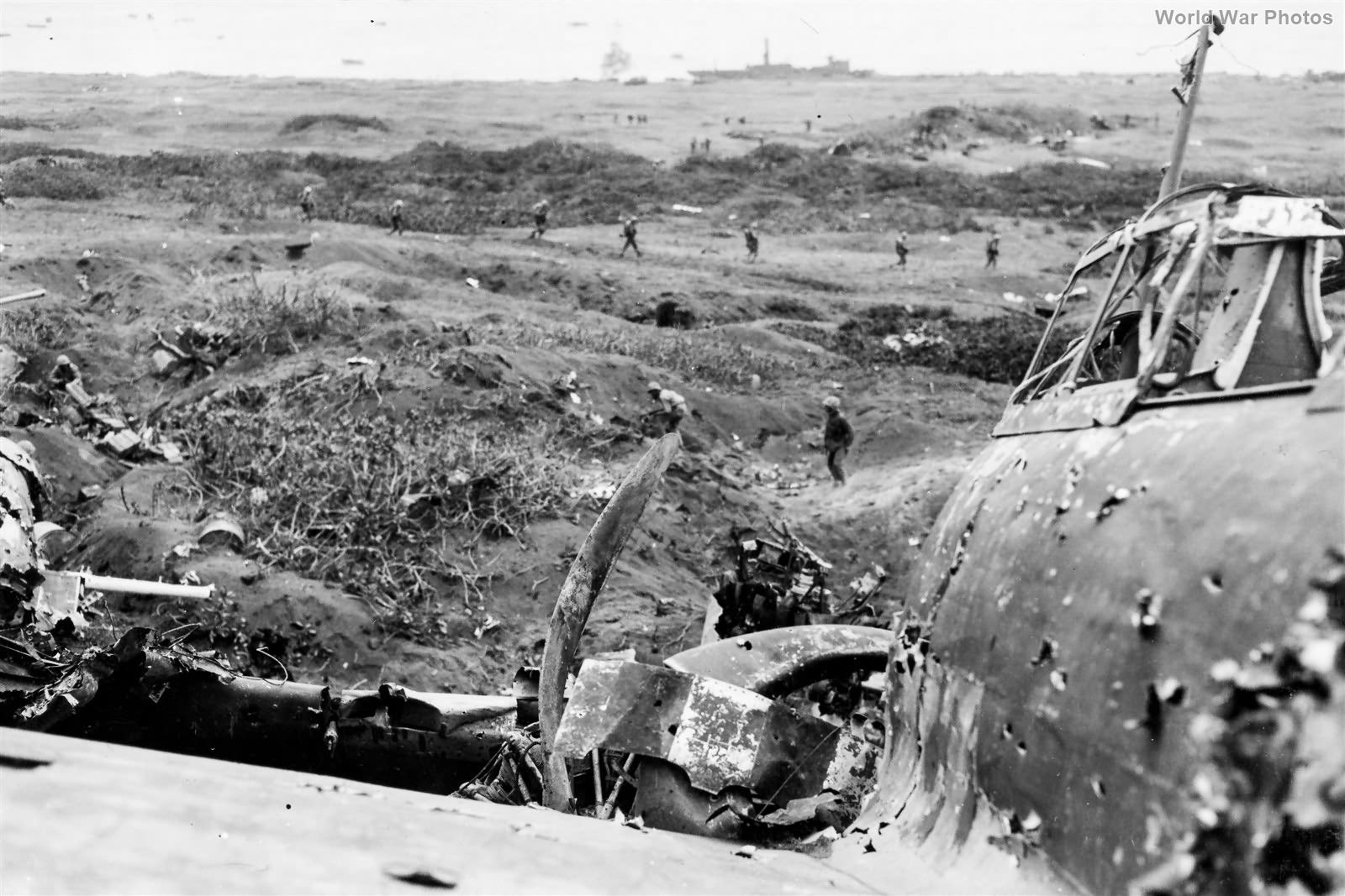 23rd Marines clear pillbox by wrecked A6M5
