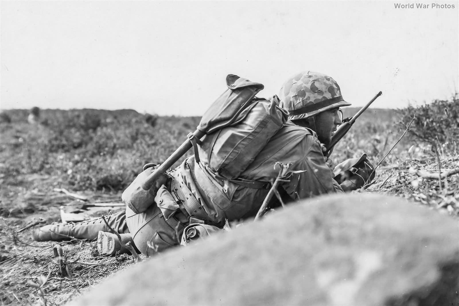 3/21 Marines crawling forward under fire at Airfield 2 Iwo Jima 24 February 1945