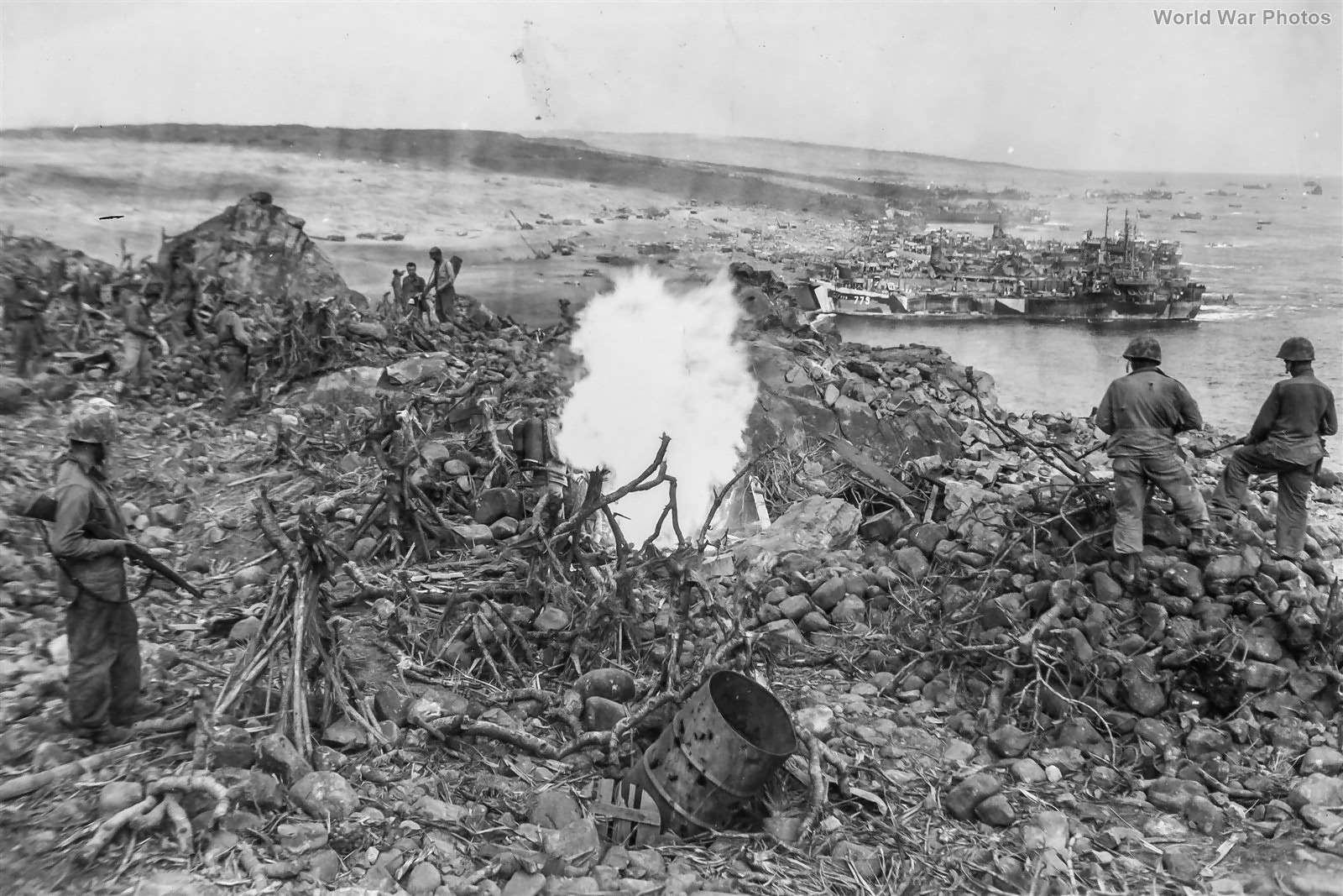 9th Marines use flame thrower on pillbox overlooking landing beaches 24feb