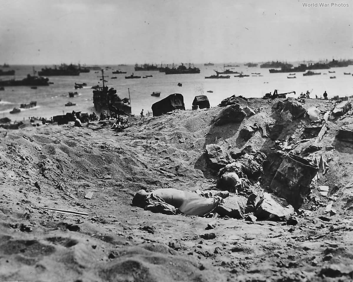 Dead Japanese lie in a shell hole on the ashy slopes below Mt Suribachi