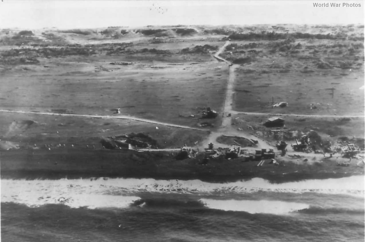 Japanese Soldiers Run for Cover as US Plane Flies over Iwo Jima
