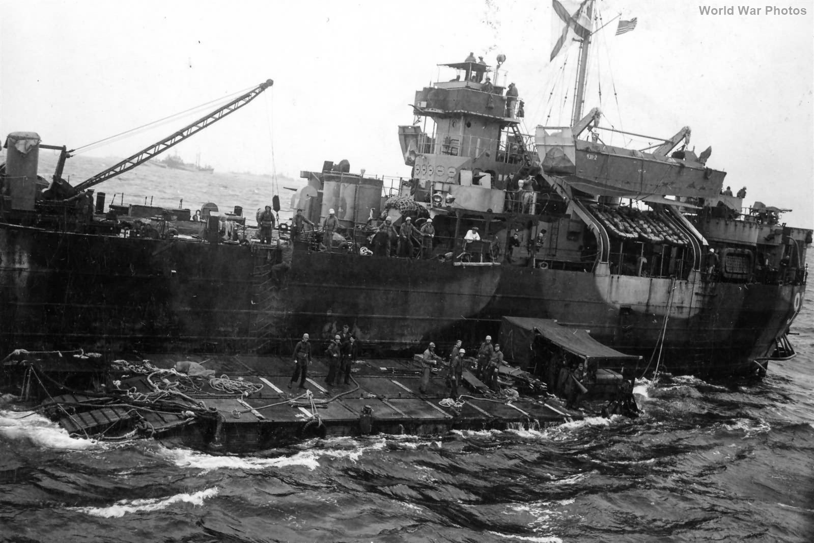 LST with barge recovering wounded Marines Iwo Jima