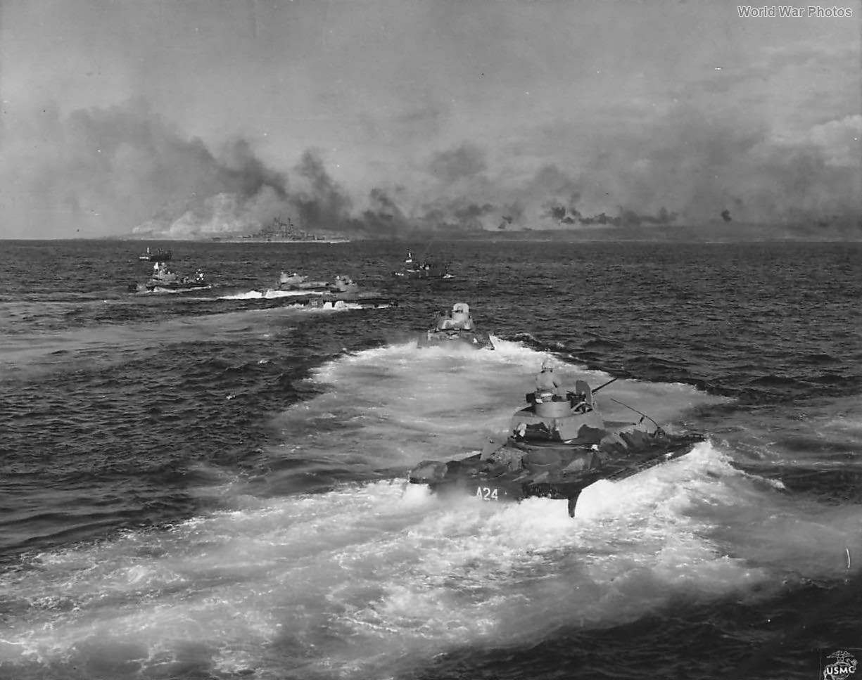 LVTs Head for Invasion Shore as Battleship blasts Iwo Jima