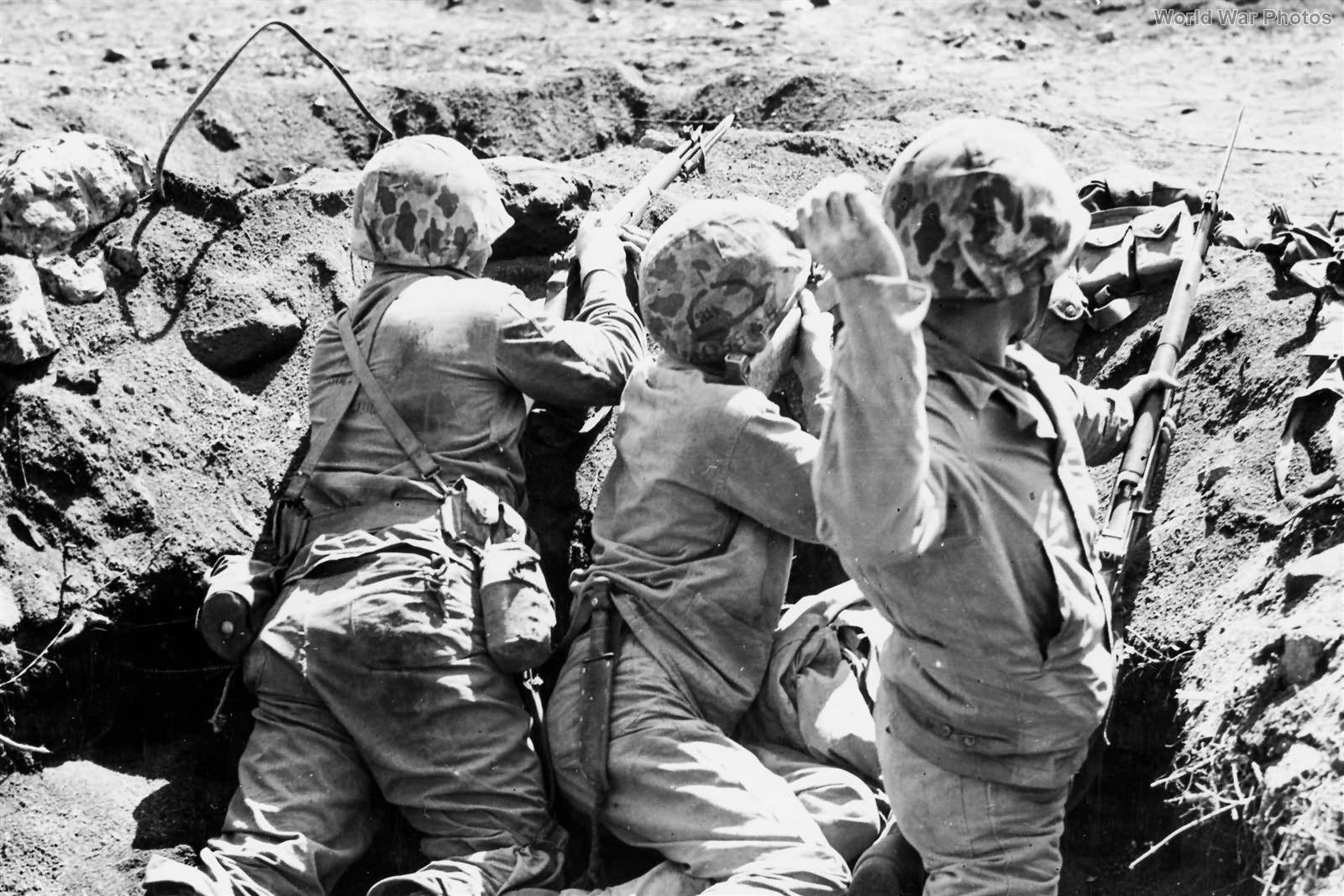 Marine Throws Grenade on Iwo Jima February 1945