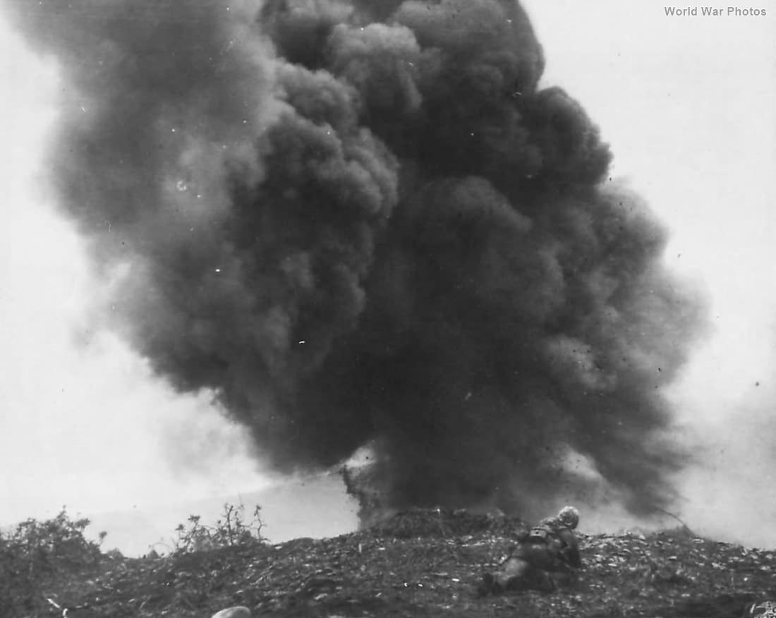 Marine demolition man blasts Japanese Pillbox on Iwo Jima