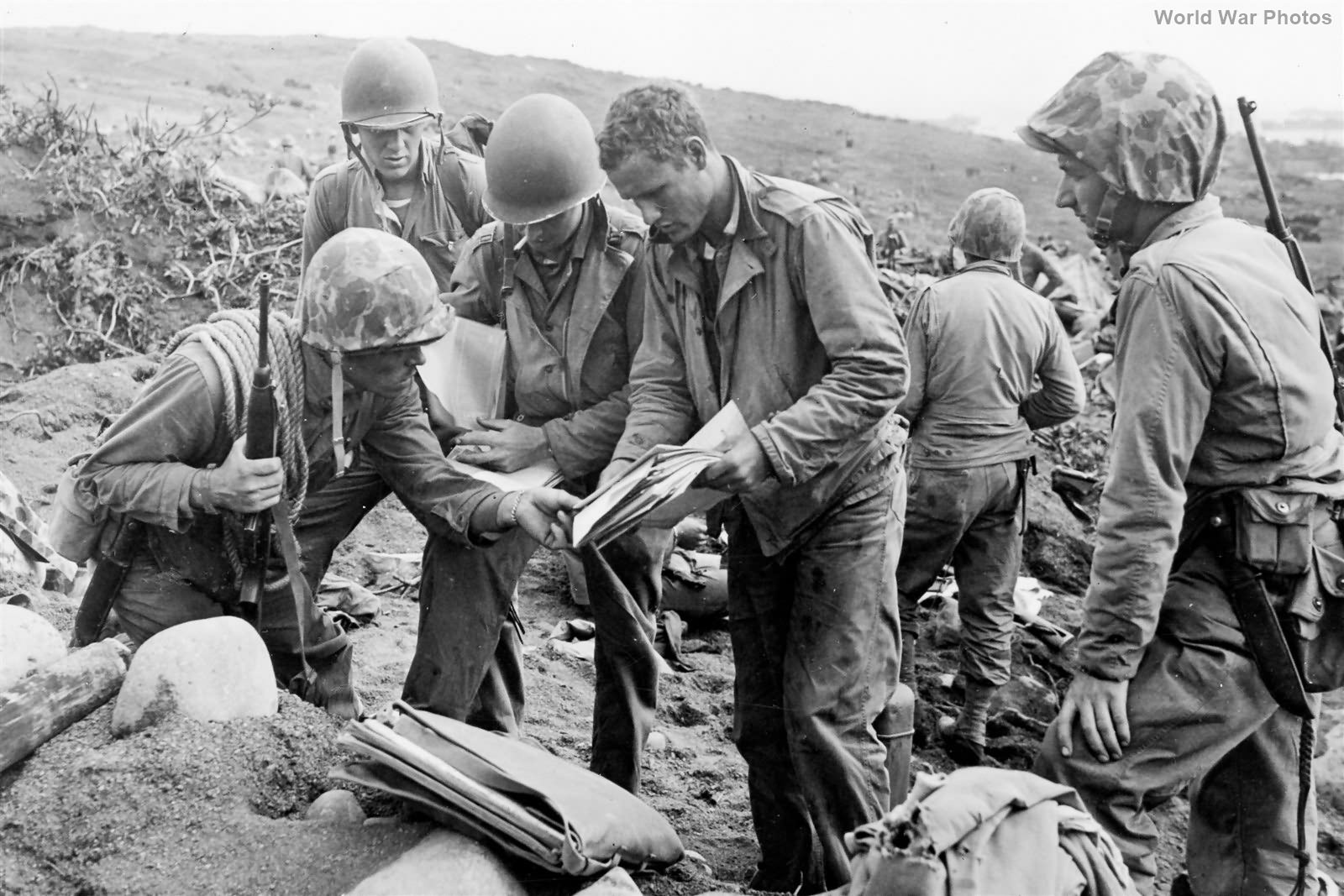 Marine patrol studies Japanese maps on Iwo Jima