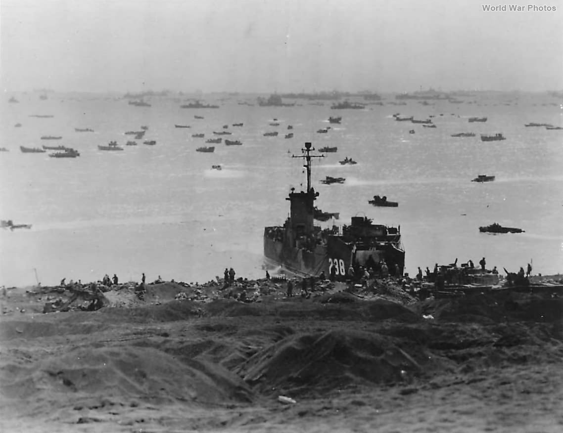 Marines unloading supplies from LSM-238 on Iwo Jima Beach