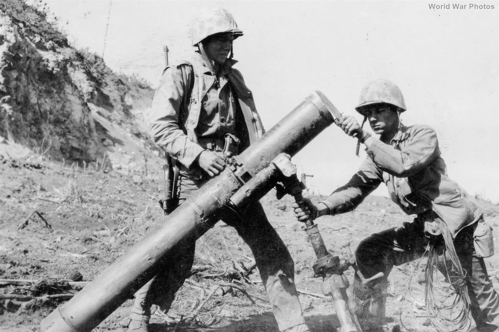 Marines with massive 155mm Japanese Mortar on Iwo Jima