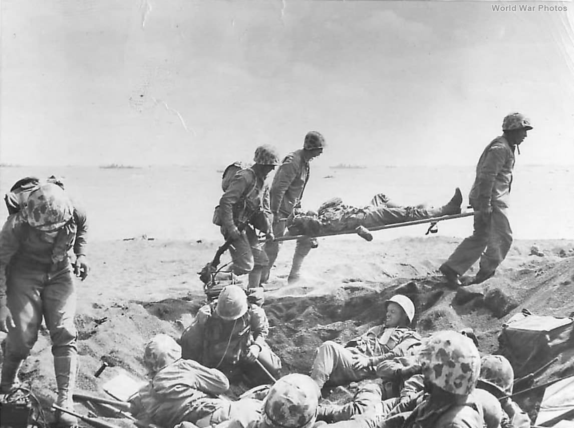 Medics carry wounded Marine on Iwo Jima