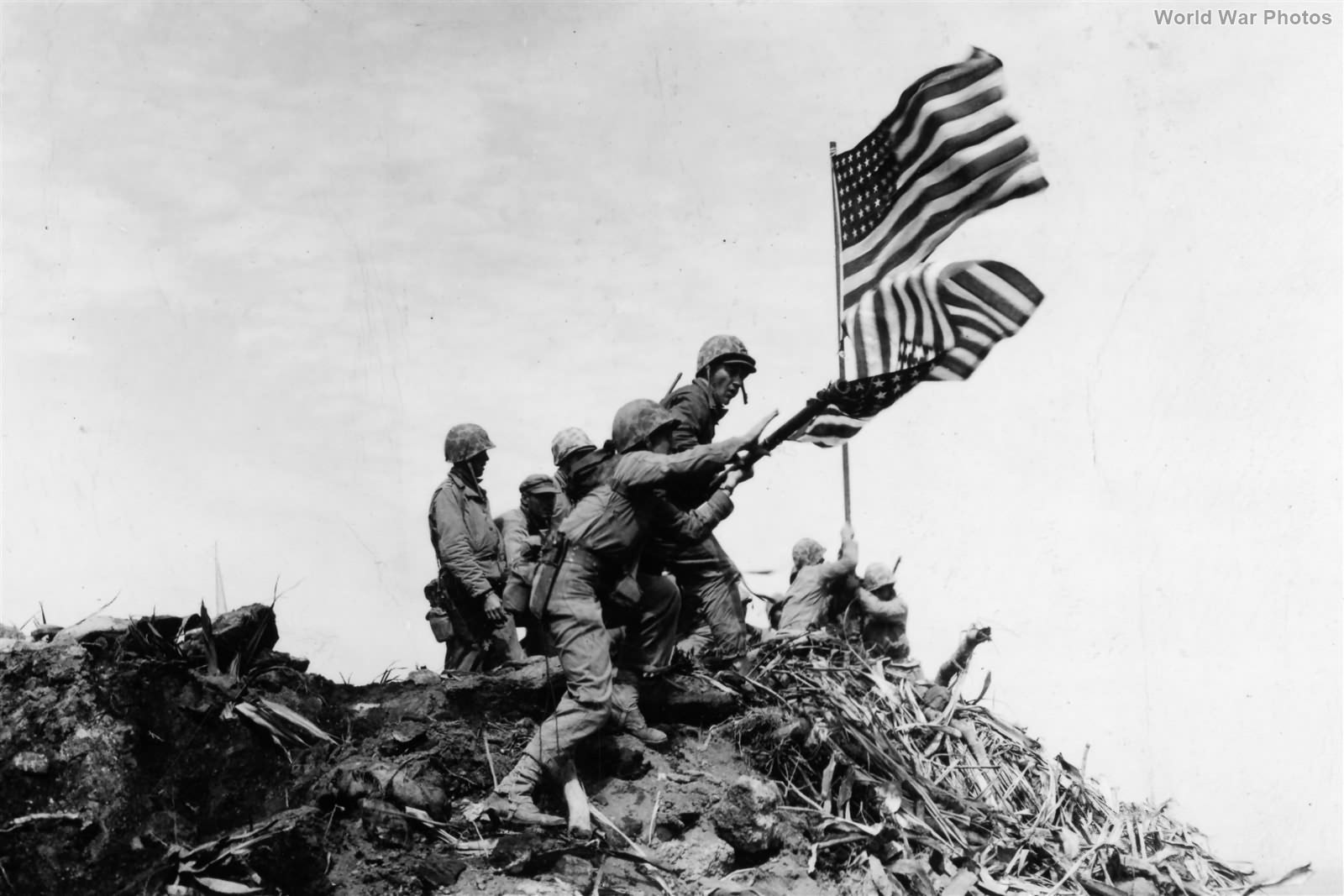 Preparing to raise the 2nd Flag on Mt Suribachi Iwo Jima 23feb