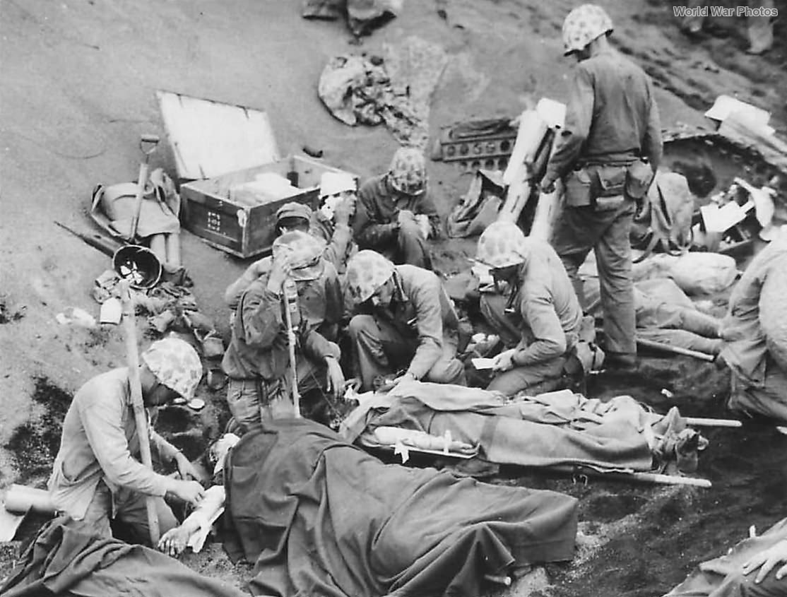 Wounded Marines being treated at Aid Station on Iwo Jima